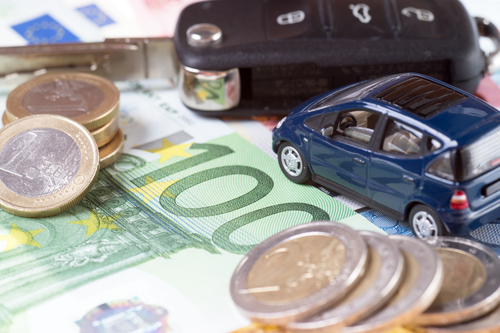 car and euro money with car key